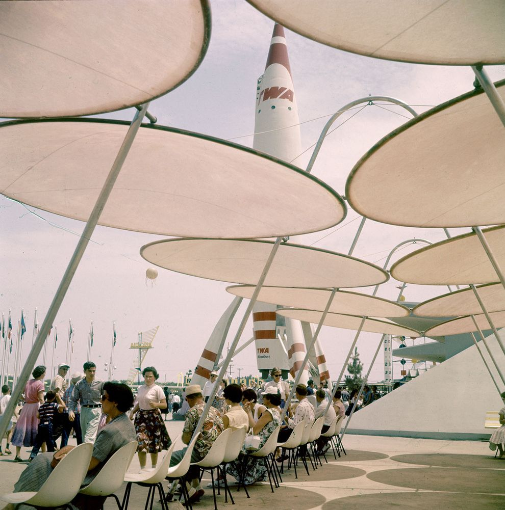 Guests Enjoy A Nice Break In The Shade Near The TWA Rocket In - 18 amazing rare colour photos disneyland 1955