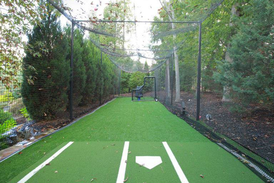 From Christie's - This property boasts a large playing field with stone stadium seating, organic and perennial gardens, full-size sports court and batting cage.