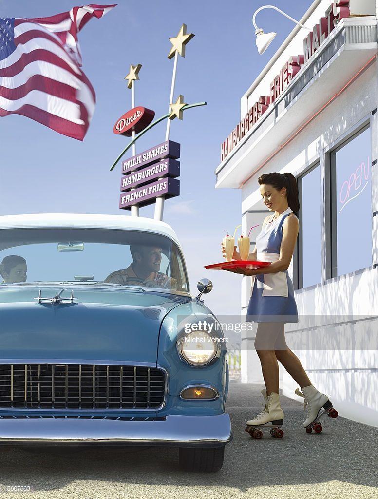 Vintage car and carhop at retro diner
