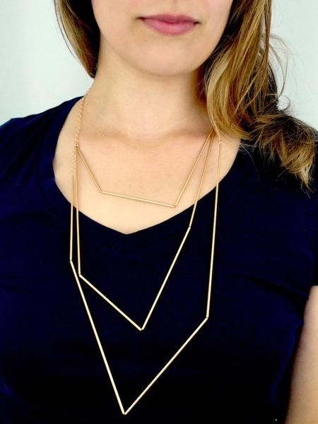 90327014f8710 This beautiful necklace is bold and elegant. The small tubes form a layered  geometric shape. The metal tubes are strung over a delicate chain and  handmade ...