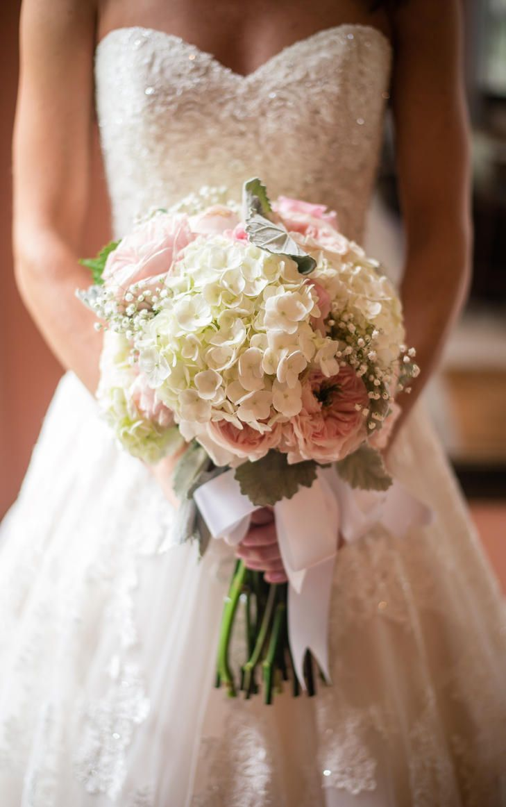 This bridal bouquet includes a mix of light pink garden roses, white ...
