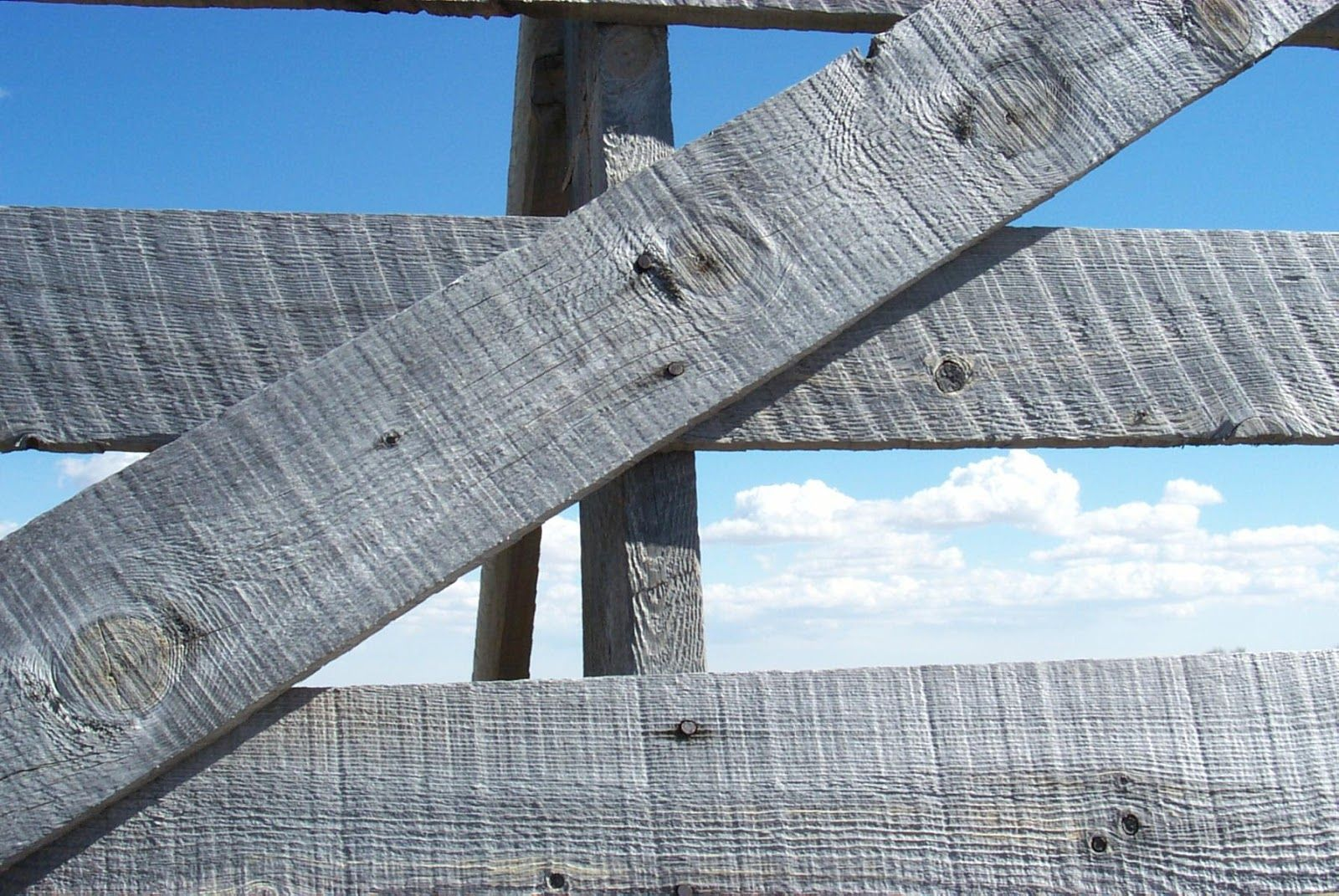 Centennial Woods Llc Was Founded In 1999 To Reclaim And Repurpose Weathered Wood From The Snow Fences In The P Reclaimed Wood Siding Reclaimed Wood Wood Siding