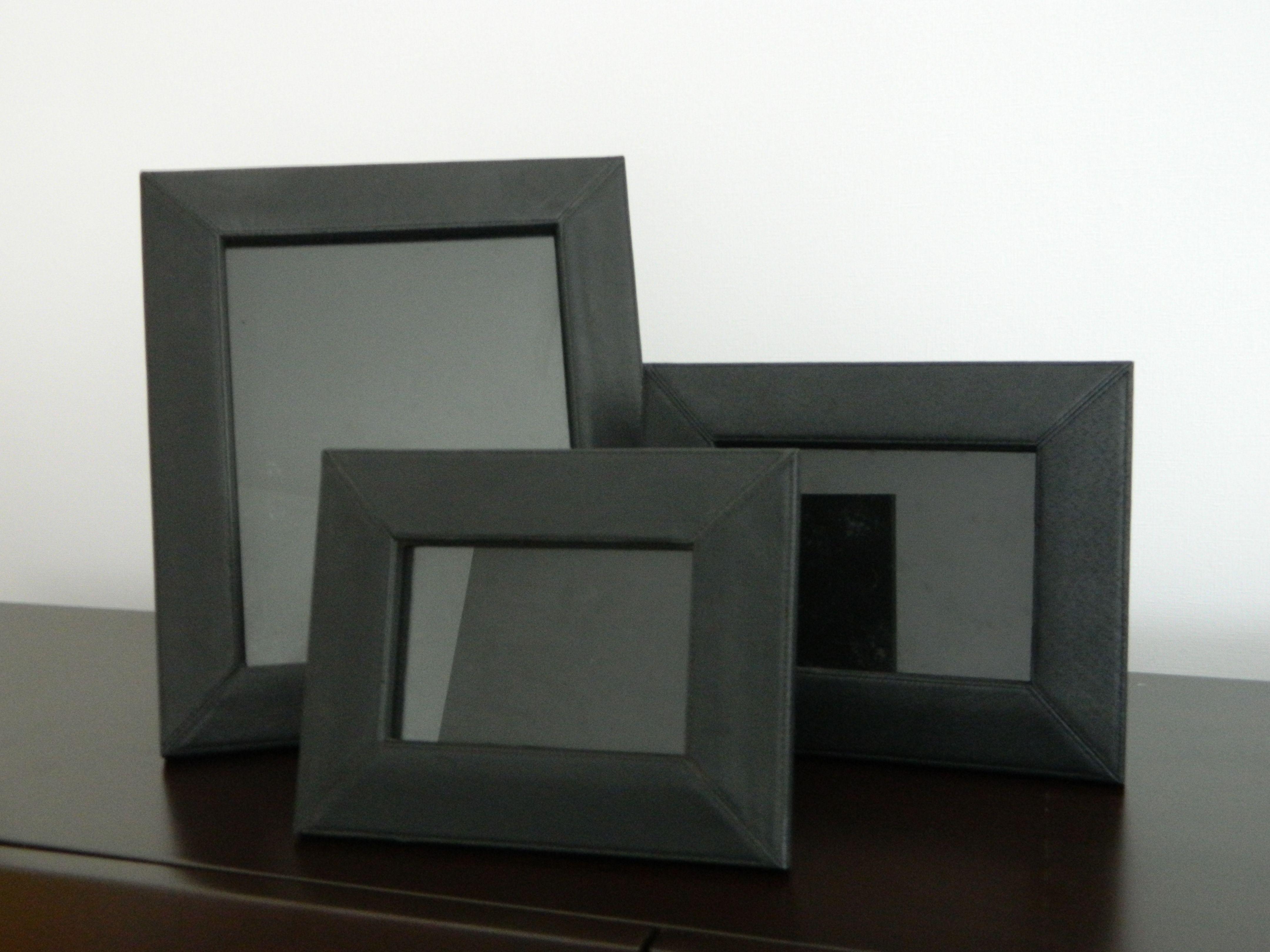 Tres marcos de cuero negro 100 soles