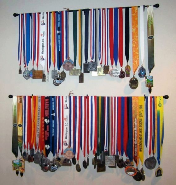 Use a curtain rod to display running medals this is cool for Curtain display ideas