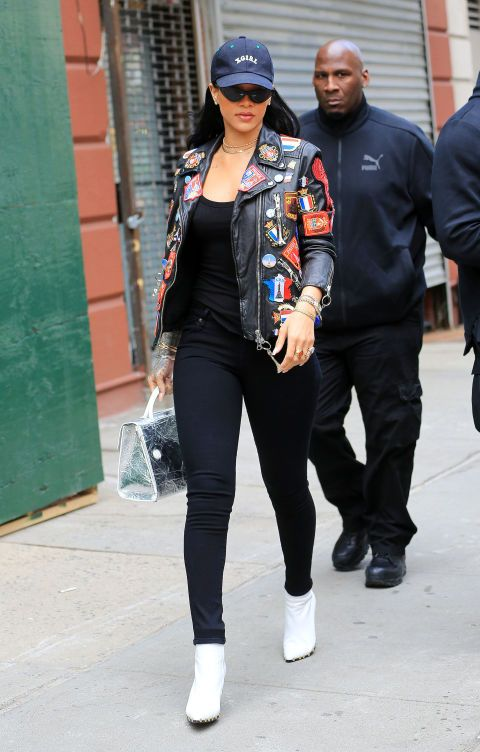RiRi stopped off in NYC in between stops on her ANTI Tour wearing a statement leather jacket with a black tee and jeans, accessorized with white booties, a baseball cap, and her Adam Selman x Le Specs sunglasses.