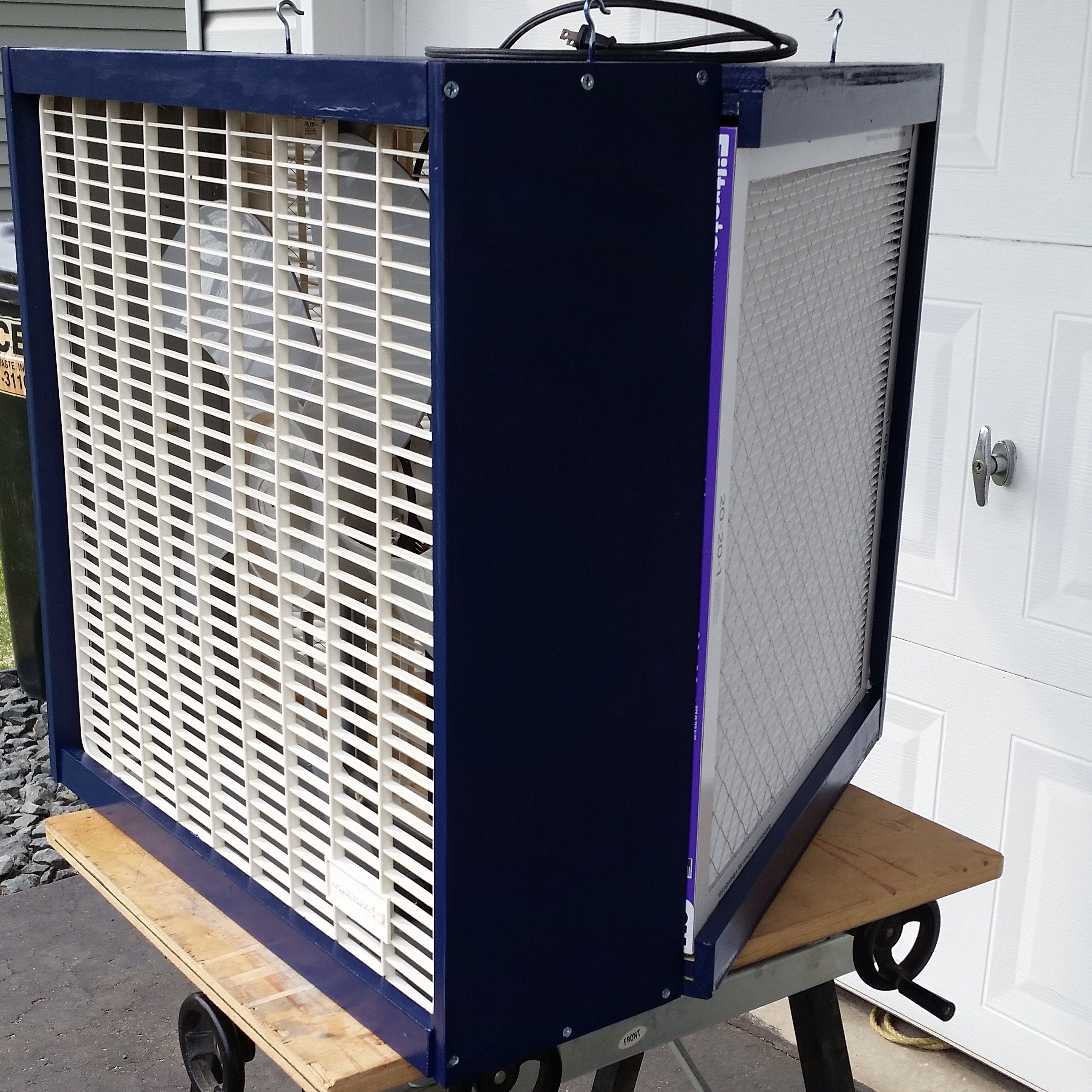 Shop air filtration using a box fan and twin furnace