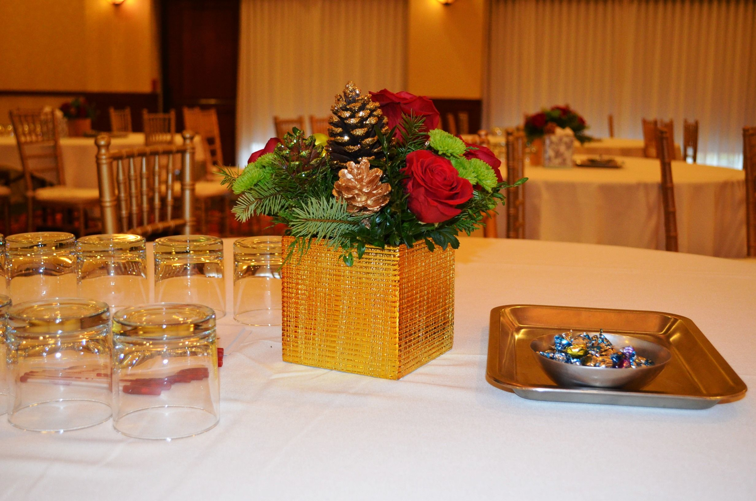 Simple Floral Centerpieces For A Holiday Corporate Luncheon Flowers Stimulate Crea Holiday Centerpieces Corporate Events Decoration Simple Floral Centerpieces