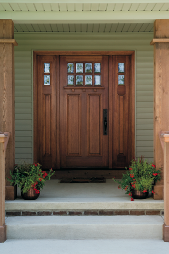 Wood doors and sidelights with beveled glass create a for Wooden back doors with glass