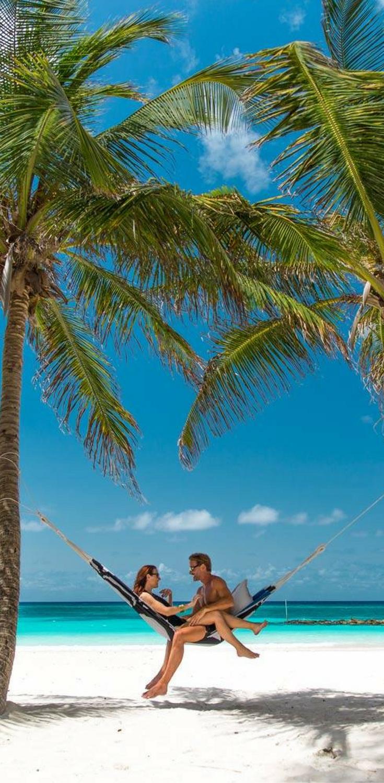 swing above white sand in these beachside hammocks for two    sandals resorts weddings   swing above white sand in these beachside hammocks for two      rh   za pinterest