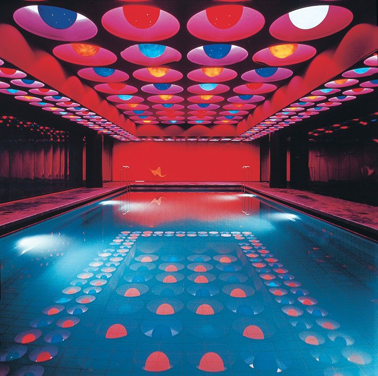 """To swim in that pool!""""The furnishing of the Spiegel Publishing house buildings in  Hamburg count among the most outstanding examples of Panton's interior  designs and are some of the few that still exist, at least in part. For  the famous news magazine which moved into the modernized premises in  1969 in Hamburg's Ost-West Street, Panton designed the entrance area  with courtyard and lobby, the canteen and the bar areas, the swimming  pool for the employees in the basement of the building…"""