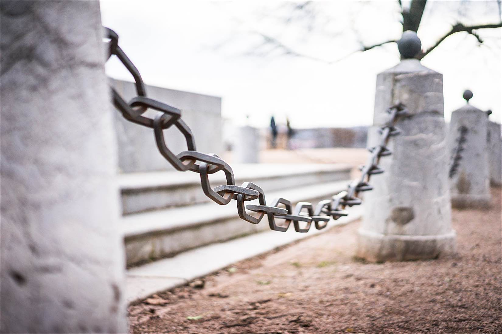 Iron Chain Around Historic Monument Free Stock Photo