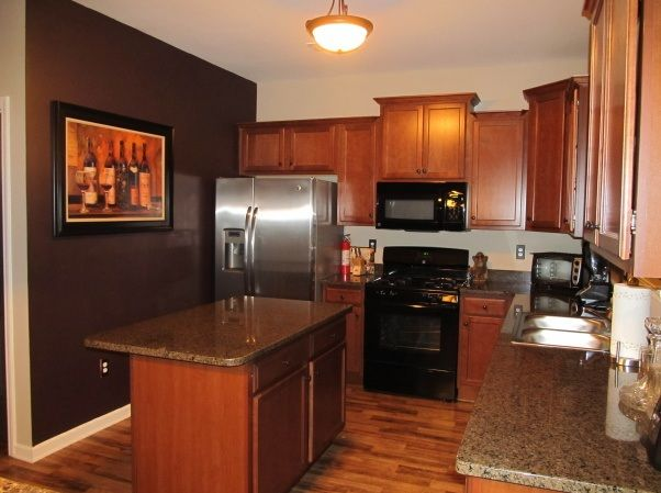 Wine kitchen decor with framed wine photo and dark brown paint ...