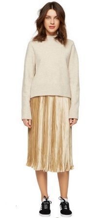 Beige sweater+golden pleated midi skirt+black sneakers with white details. Fall Casual Outfti 2016