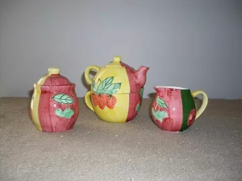 From my collection .. Tea for One set with matching creamer and sugar dish .. also have a matching vase