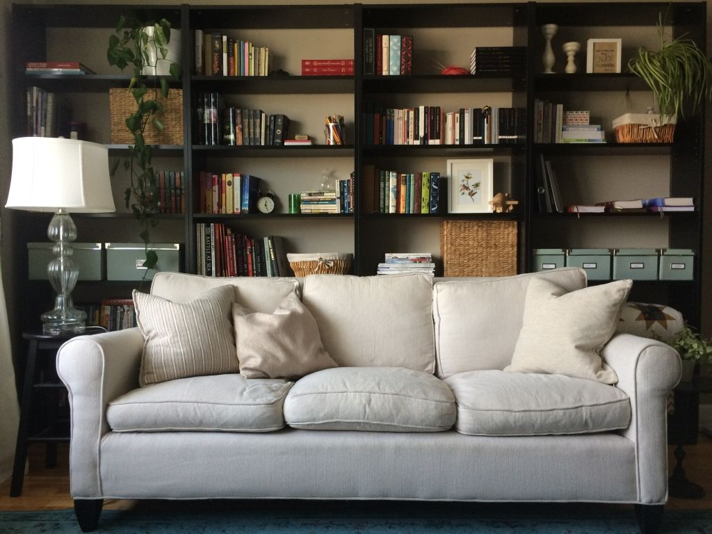 Line Your Living Room With Bookshelves With Images Bookshelves In Living Room Couch Furniture Bookcase Behind Sofa