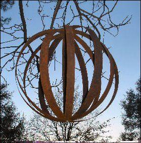 barrel art gardening   Jeannes-barrel-rounds-hanging-high-in-a-tree.jpg