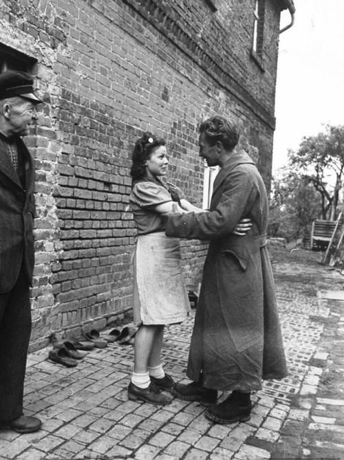 """""""After being released from Allied detention, German POW Heinz Pelschner reunited with his wife, June 1945."""""""