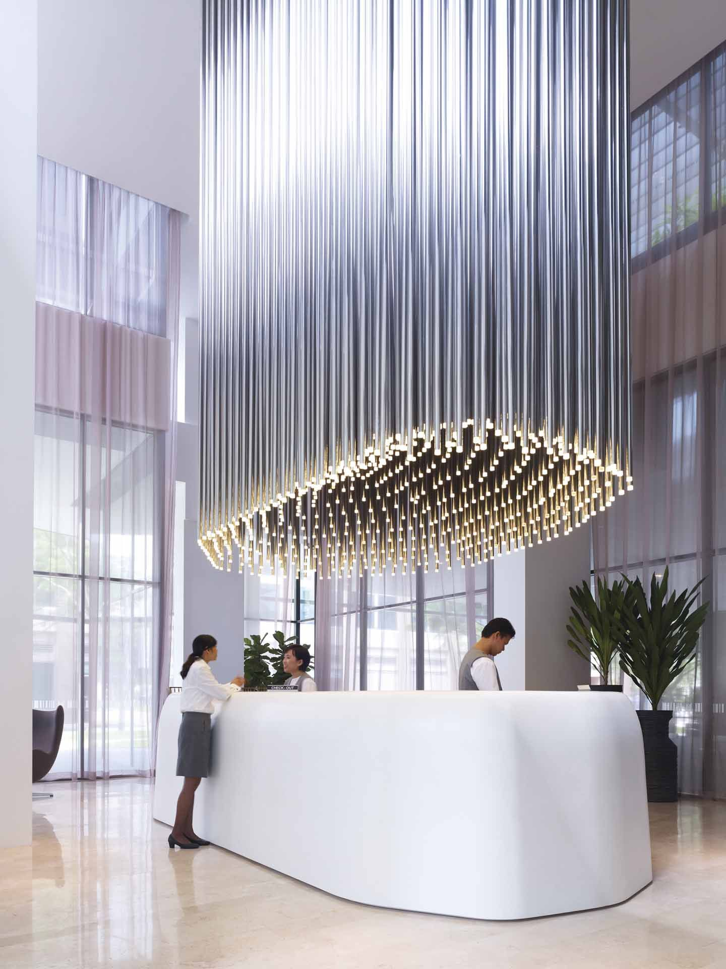 Studio M Hotel reception area in Singapore   The lighting fixture is absolutely stunning.   Find more inspiring lighting designs and solutions for your hospitality projects at Unique Blog http://delightfull.eu/blog/