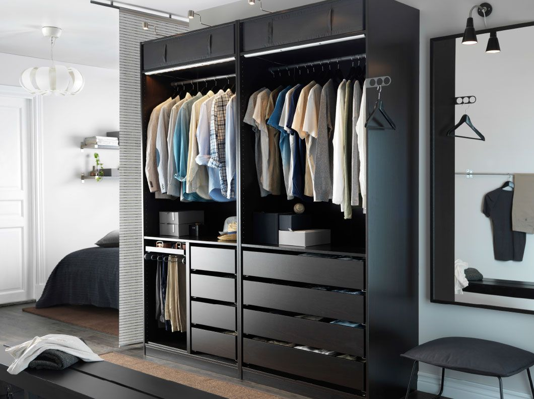 A Modern Bedroom With An Open Black Brown Pax Wardrobe Combination