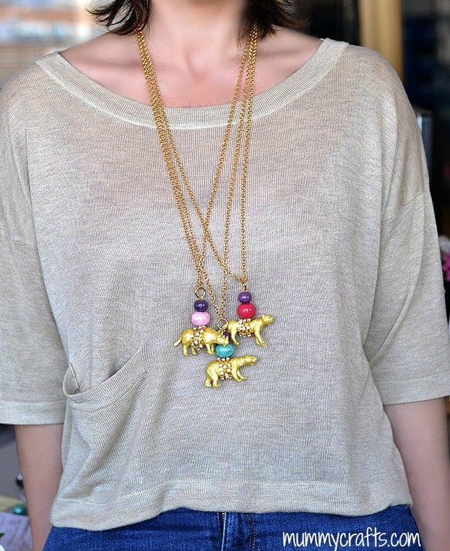 With a few beads a chain and gold spray paint plastic animals