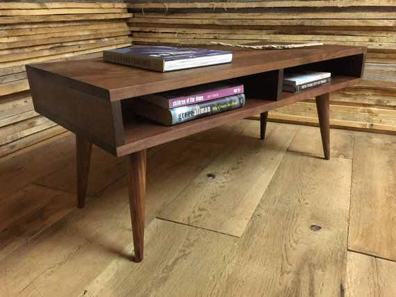 This handcrafted coffee table is part of a new line of upscale mid century style items I am building. These items feature the finest Eastern black