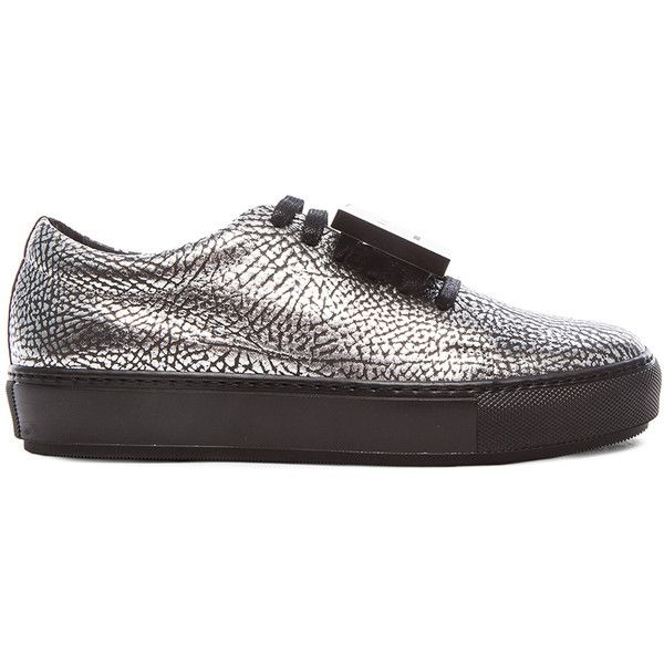 Acne Studios Metallic Adriana Sneakers (29.360 RUB) ❤ liked on Polyvore featuring shoes, sneakers, black metallic shoes, metallic sneakers, platform trainers, rubber sole shoes and black sneakers