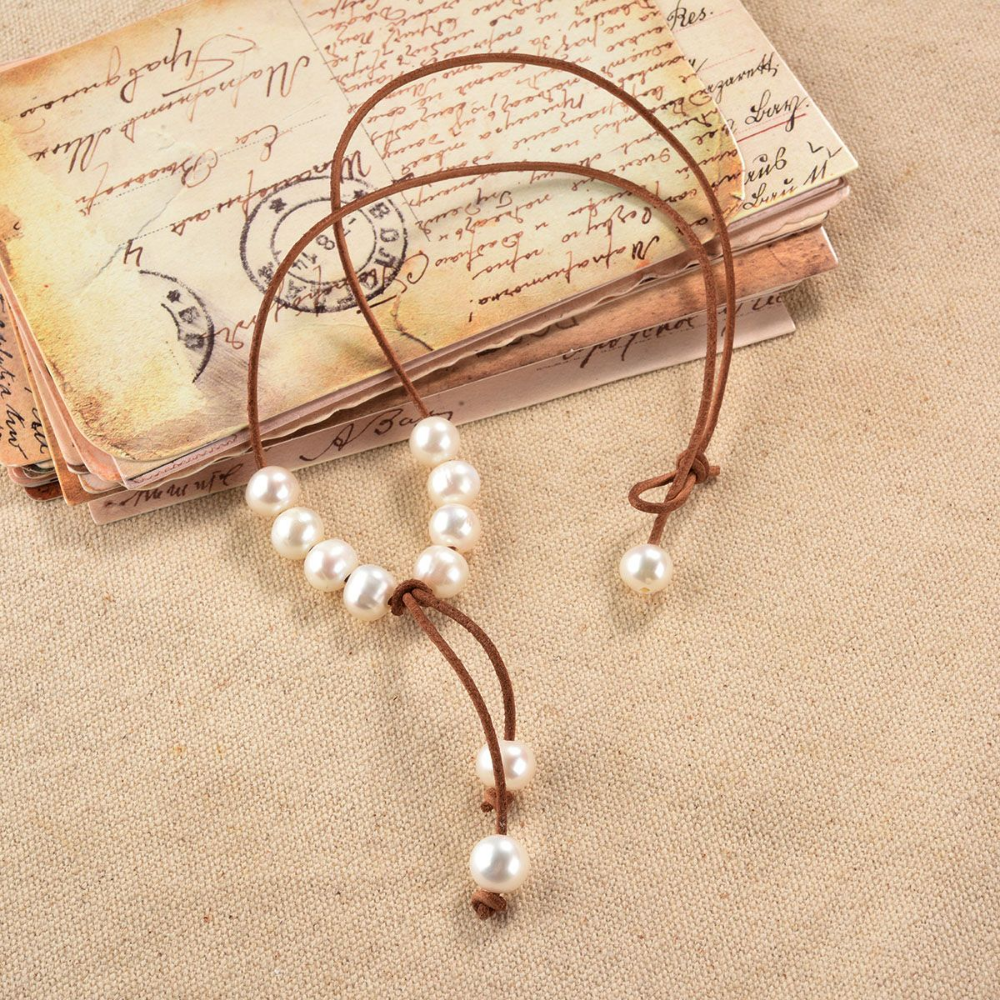 White Cultured Freshwater Pearl on Leather Cord Handknotted Lariat Necklace for Women is part of Leather pearl jewelry, Pearl leather, Lariat necklace, Freshwater cultured pearls, Womens necklaces, Leather cord - Eight rice freshwater pearls on 1 5mm leather cord with drop pearl dangle and pearl closure