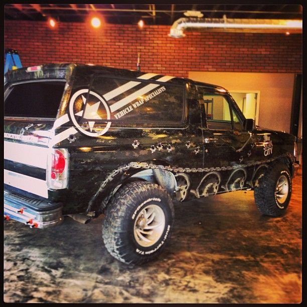 Ford Bronco Vehicle Wrap In Camo With Tank Tracks By Sign City In Detroit Camo Truck Accessories Camo Truck Camo Wraps