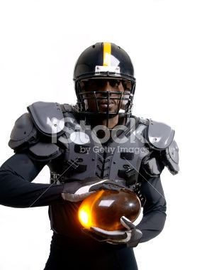 Futuristic American football player with pads