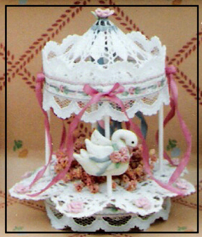 Free holiday Crochet Patterns | Crochet Swan Carousel Variation: