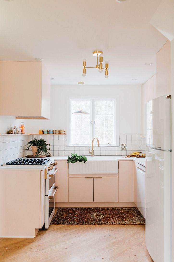 After This Pennsylvania Home Works Shades of Pink Like No One's Business - Kitchen design, Kitchen renovation, Kitchen remodel, Countertop design, Kitchen cabinets makeover, New kitchen - Chris and Claudia Beiler transformed a home in Lancaster, Pennsylvania into a retro dream house with plenty of pink