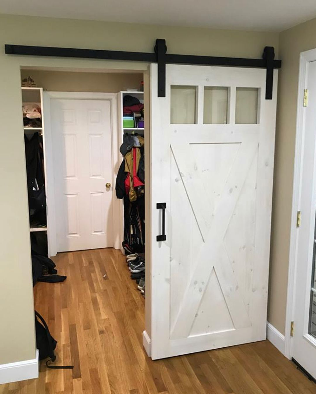 One Of Our Recently Installed 3 4 X Brace With Border Barn Doors With 3 Glass Panels And Whitewash Stai Interior Barn Doors Diy Interior Barn Doors Barn Door