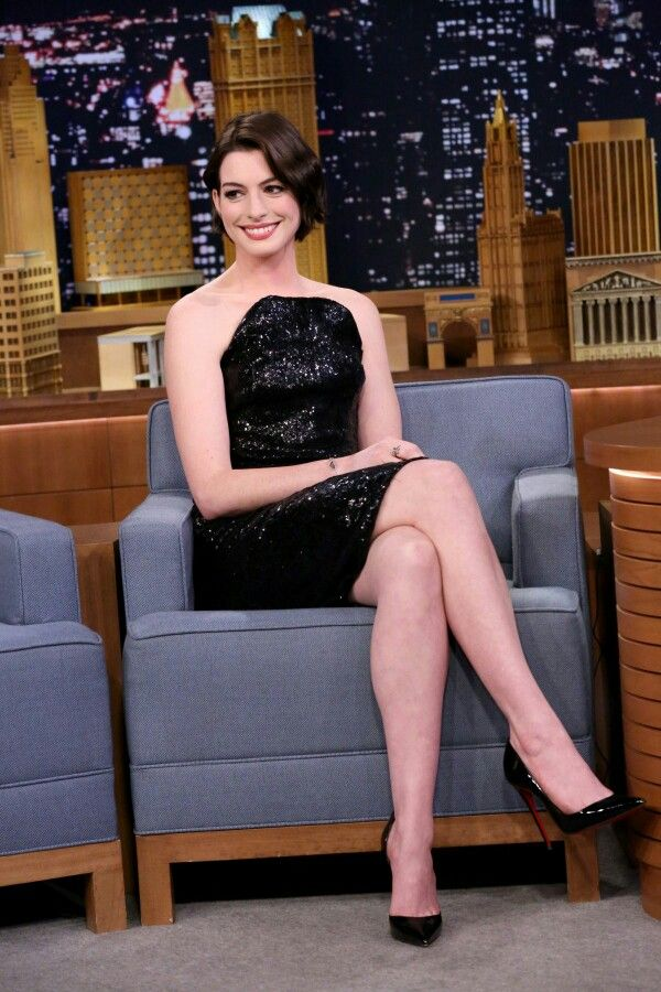 anne hathaway crossed legs in a little black dress and high heels. Black Bedroom Furniture Sets. Home Design Ideas