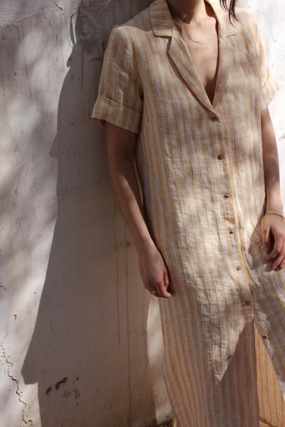 Midi-length shirt dress by Spanish brand Sunad. Button down closure, side slits, and pockets. Slightly oversized for a relaxed fit. 100% linen. Made ethically i