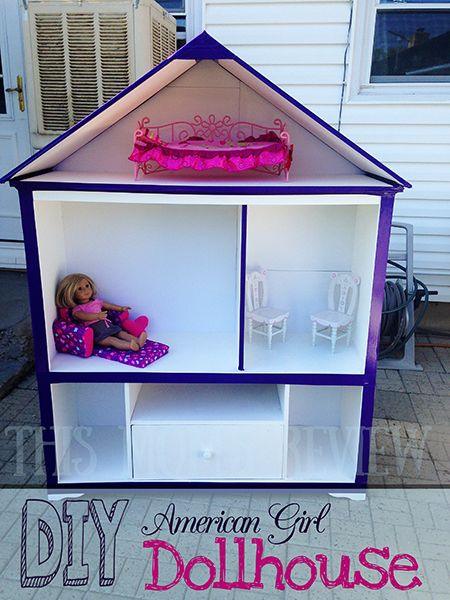 This upcycled entertainment center makes a great dollhouse for ...