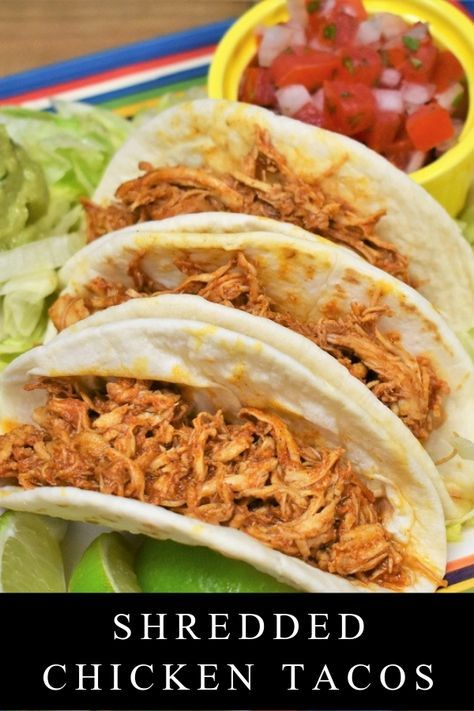 These shredded chicken tacos will give you a new, delicious way to make chicken and shake up taco night all in one easy recipe. Chicken breasts are cooked in a flavorful tomato sauce, then shredded and added back to the sauce until they soak it all up. Dress up the tacos with your favorite toppings and enjoy! #shreddedchickentacos #chickentacos via @cook2eatwell #shreddedchickentacos