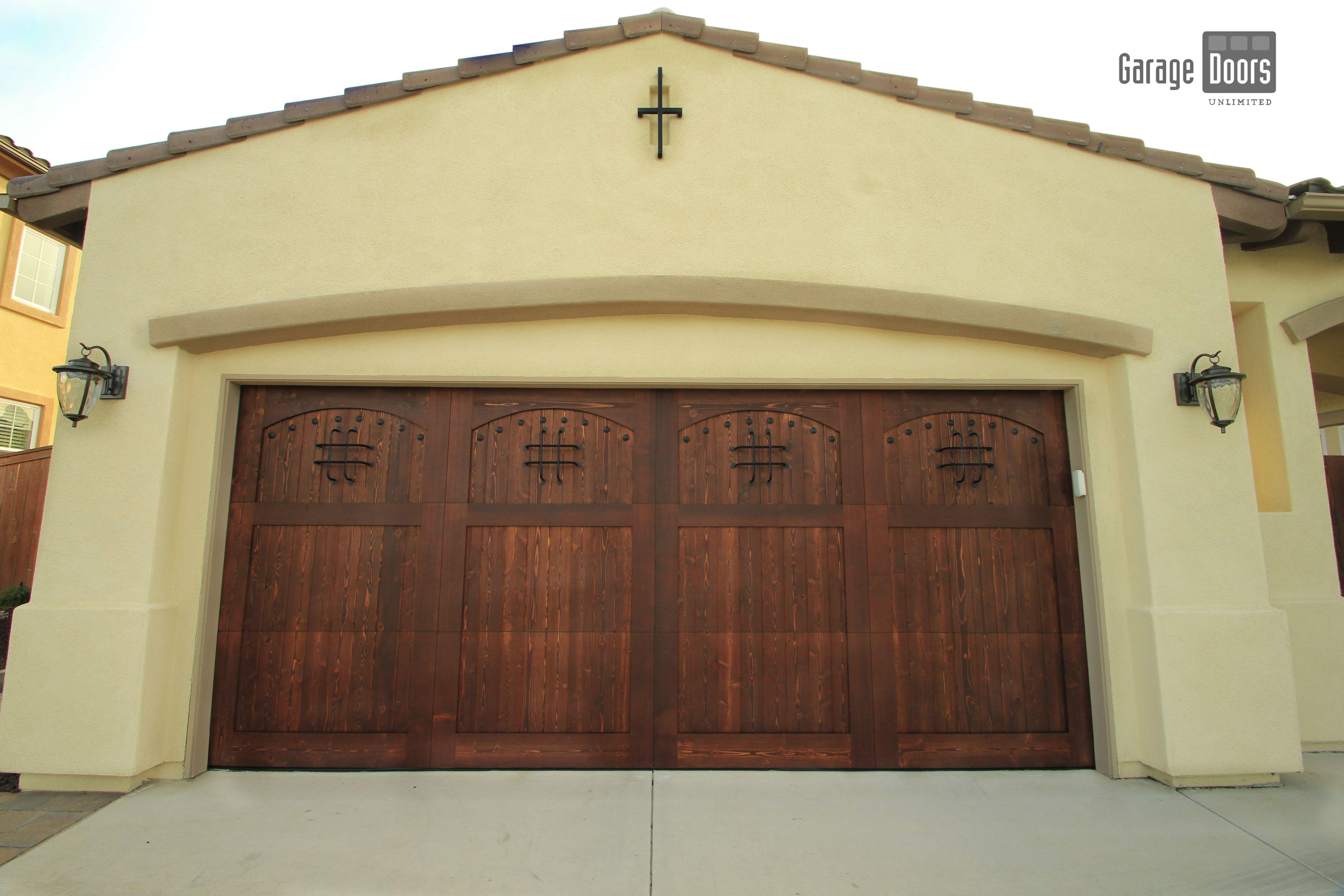 Mediterranean Style Garage Door With Speak Easy Hardware Garage Doors Wood Garage Doors House Exterior
