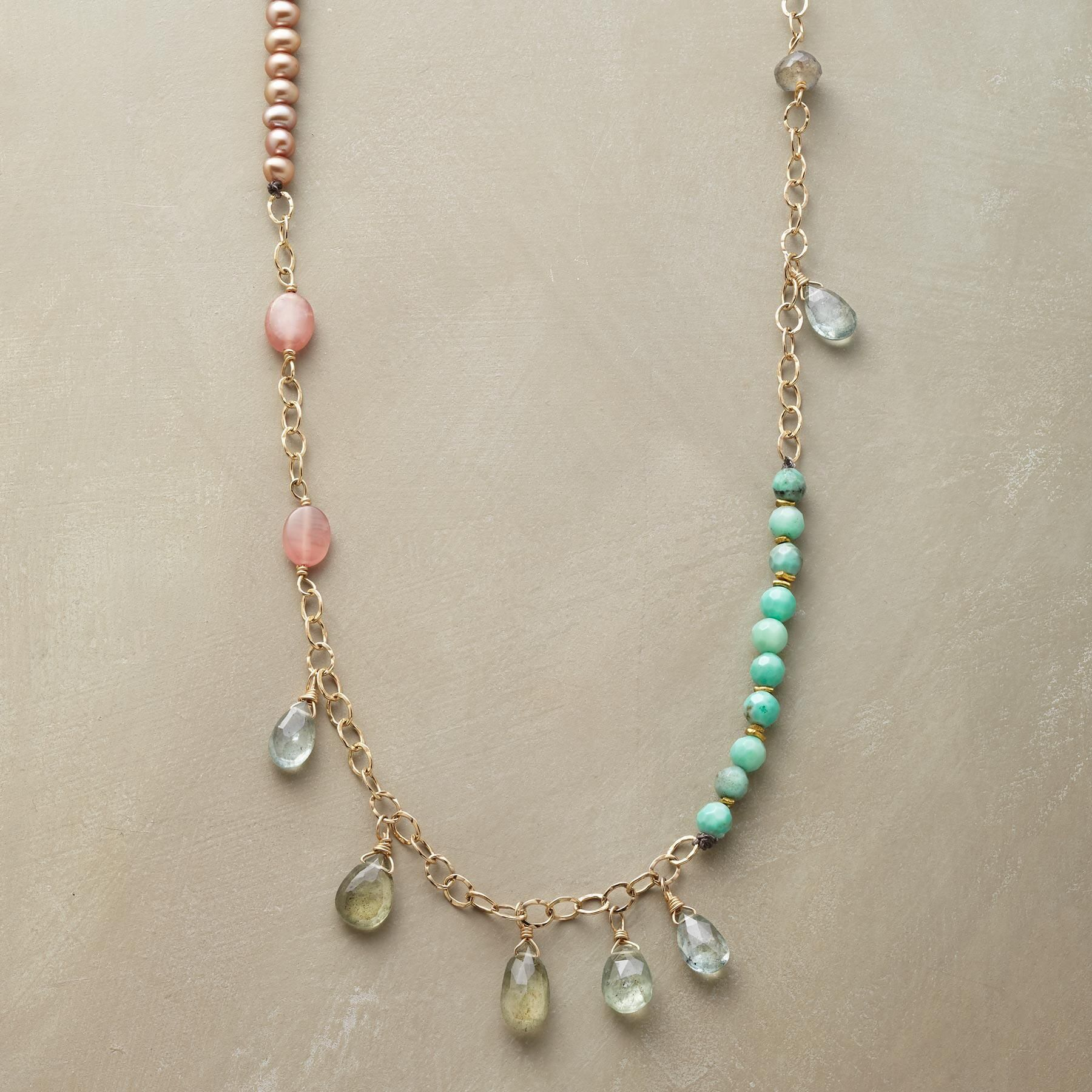 """PRIMAVERA NECKLACE--This handcrafted necklace brings together semiprecious gems in a fresh and unexpected combination—tawny pearls and shimmering labradorite, blue-green chrysoprase, rhodochrosite's subtle warmth and sparkling drops of faceted aquamarine. 12kt gold-filled chain/toggle. USA. Exclusive. 27""""L..polishingCloth {display:none"""