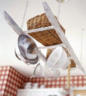 DIY hanging pot rack from a ladder.