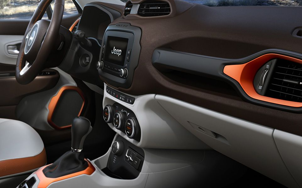 Interiors on every 2015 Jeep® Renegade feature a Wrangler-inspired grab handle.U.S. preproduction model shown.