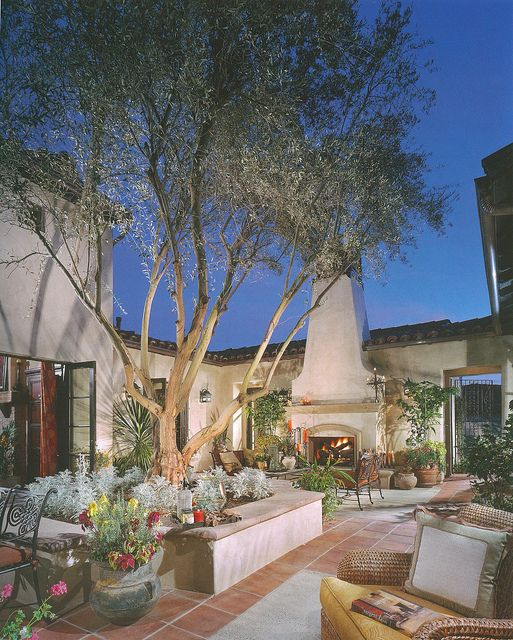Spanish Style Homes With Courtyards: Entertaining Courtyard With Fireplace And The House All