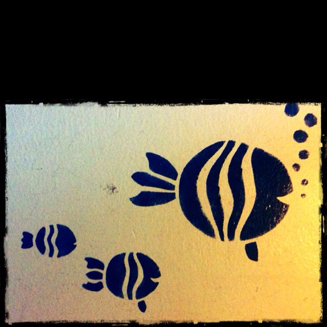 Stencils : fish I designed and painted on wall of children's bedroom