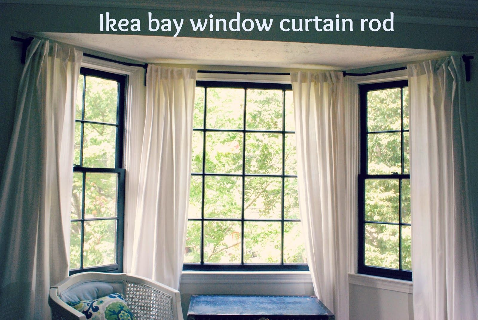 Between blue and yellow bay window curtain rod bay