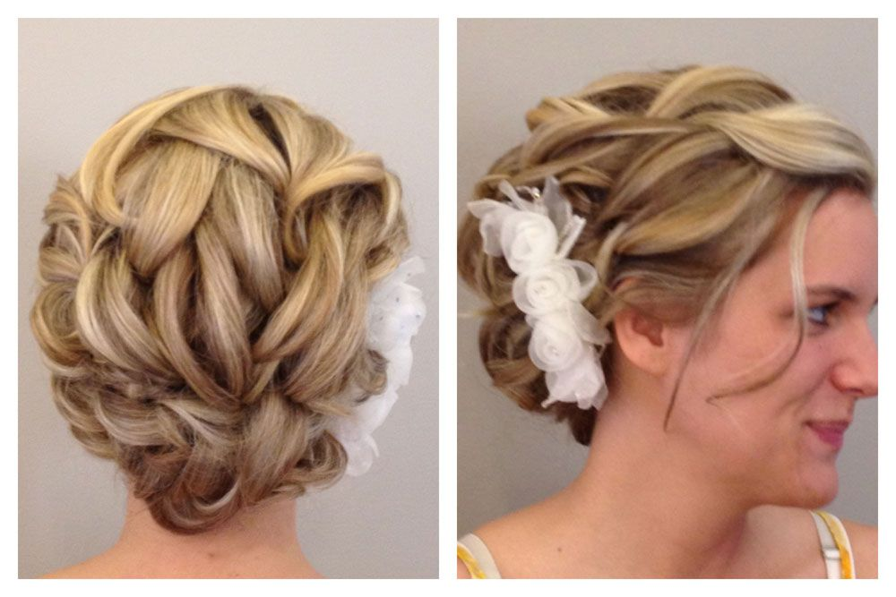 A gorgeous bridal updo, here's how to get the look! http://www.modernsalon.com/hair-photos/how-to/hair-styling-updos/Wedding-Updo-152059545.html