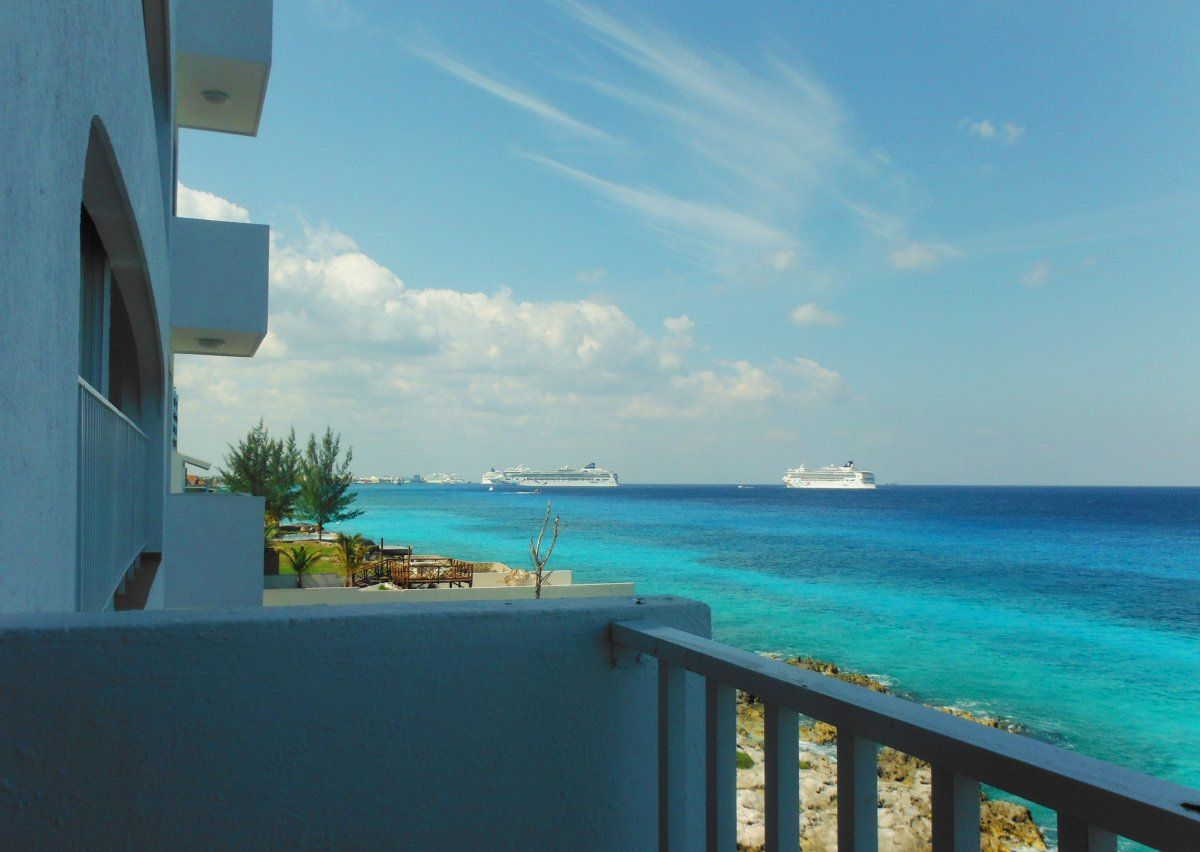 Enjoy the gorgeous oceanview of Cozumel island outside your room at Coral Princess Hotel  Resort