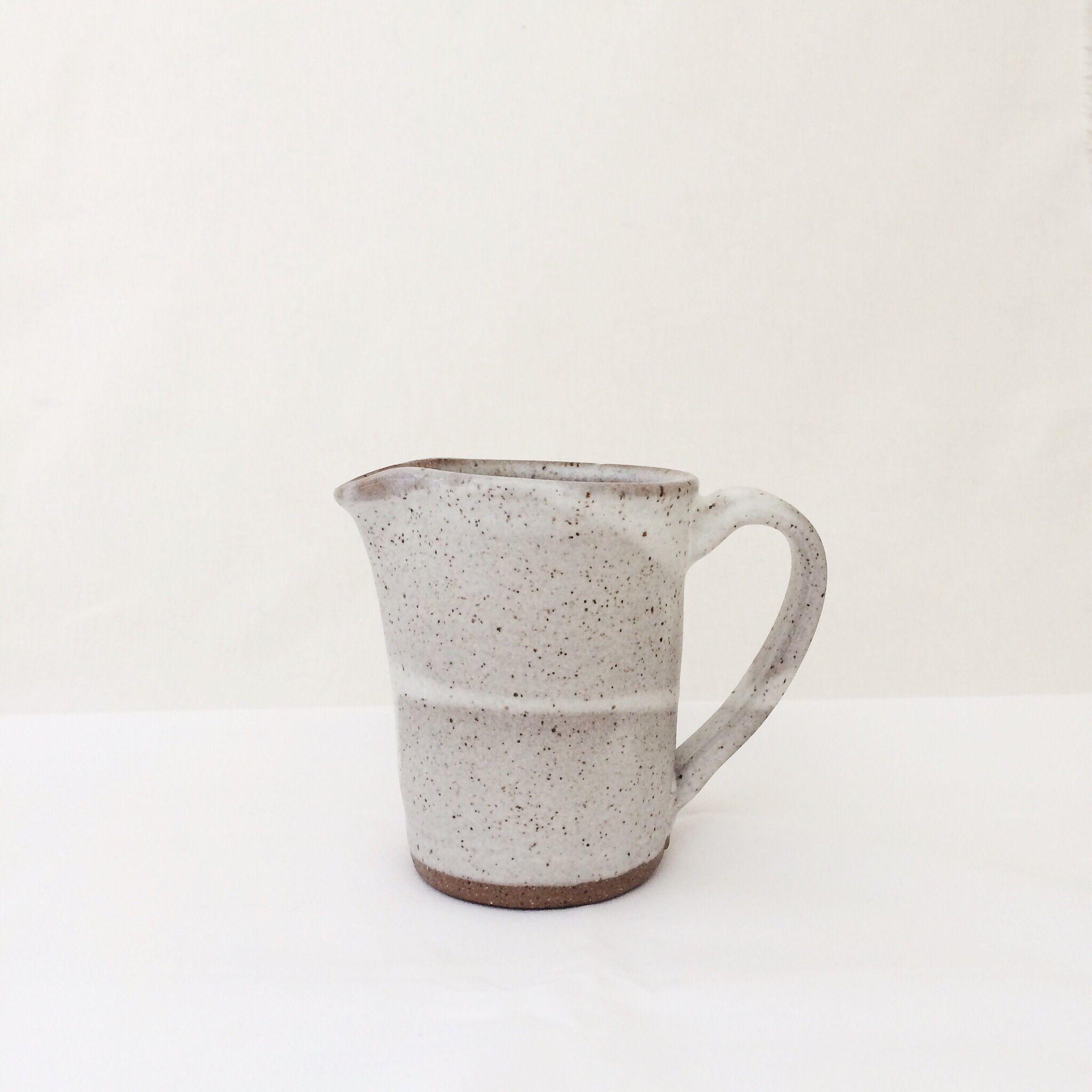 pitcher dark brown clay with speckled matte white glaze meghan