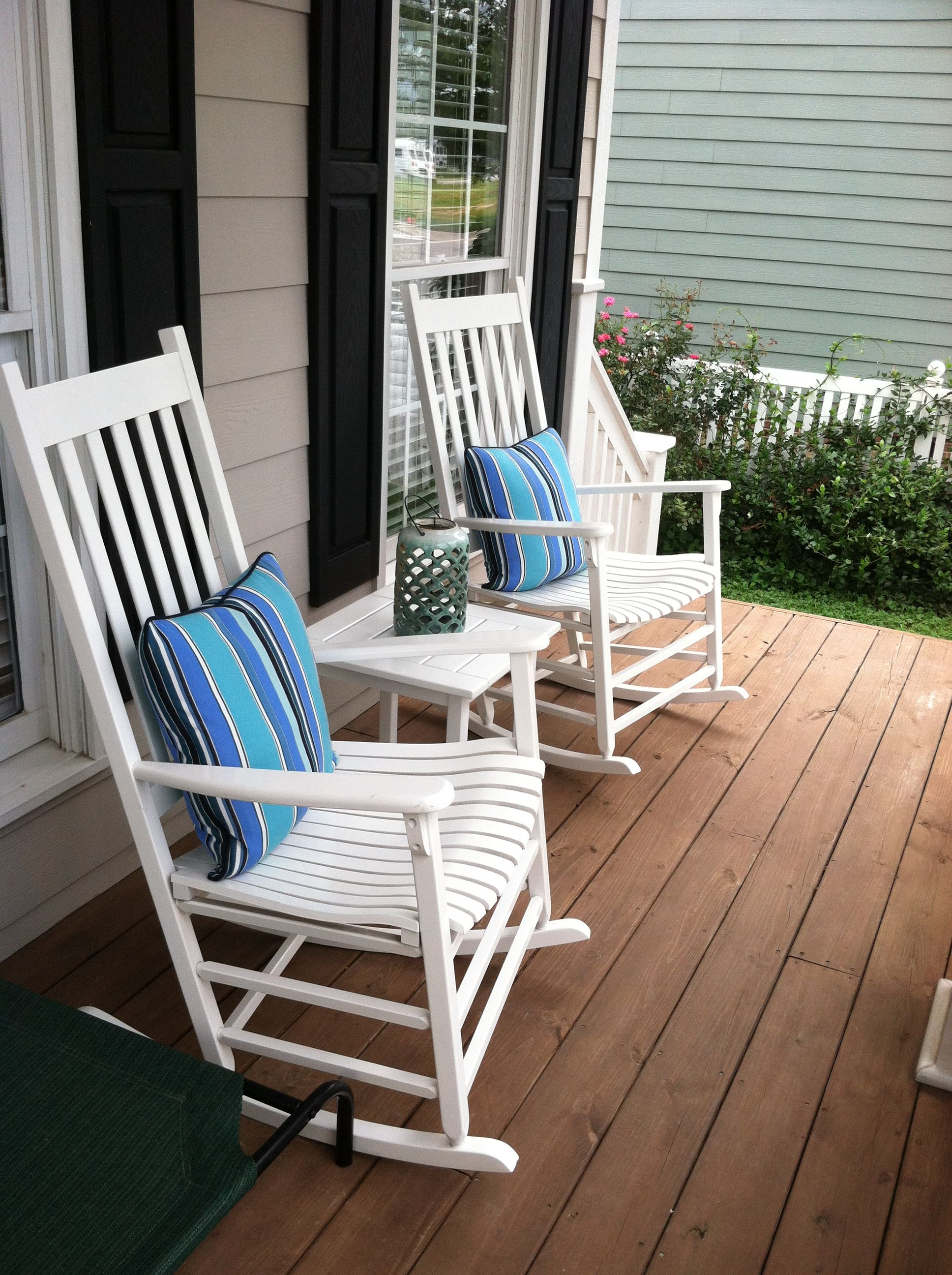 White Rocking Chairs On Front Porch With Summer Perfect Sunbrella Pillows And Ombre Lantern Front Porch Furniture Porch Furniture Patio Furniture