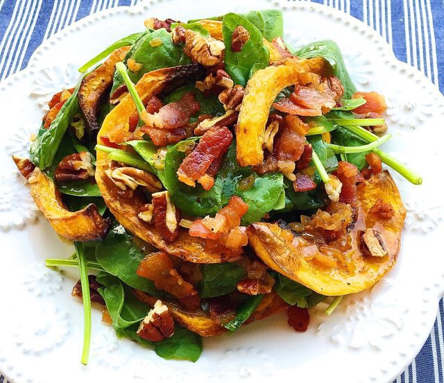 Crispy Butternut Squash Spinach Salad with Bacon-Shallot Vinaigrette  This fall salad will kill it on your Thanksgiving table.  Get the recipe from Delish.