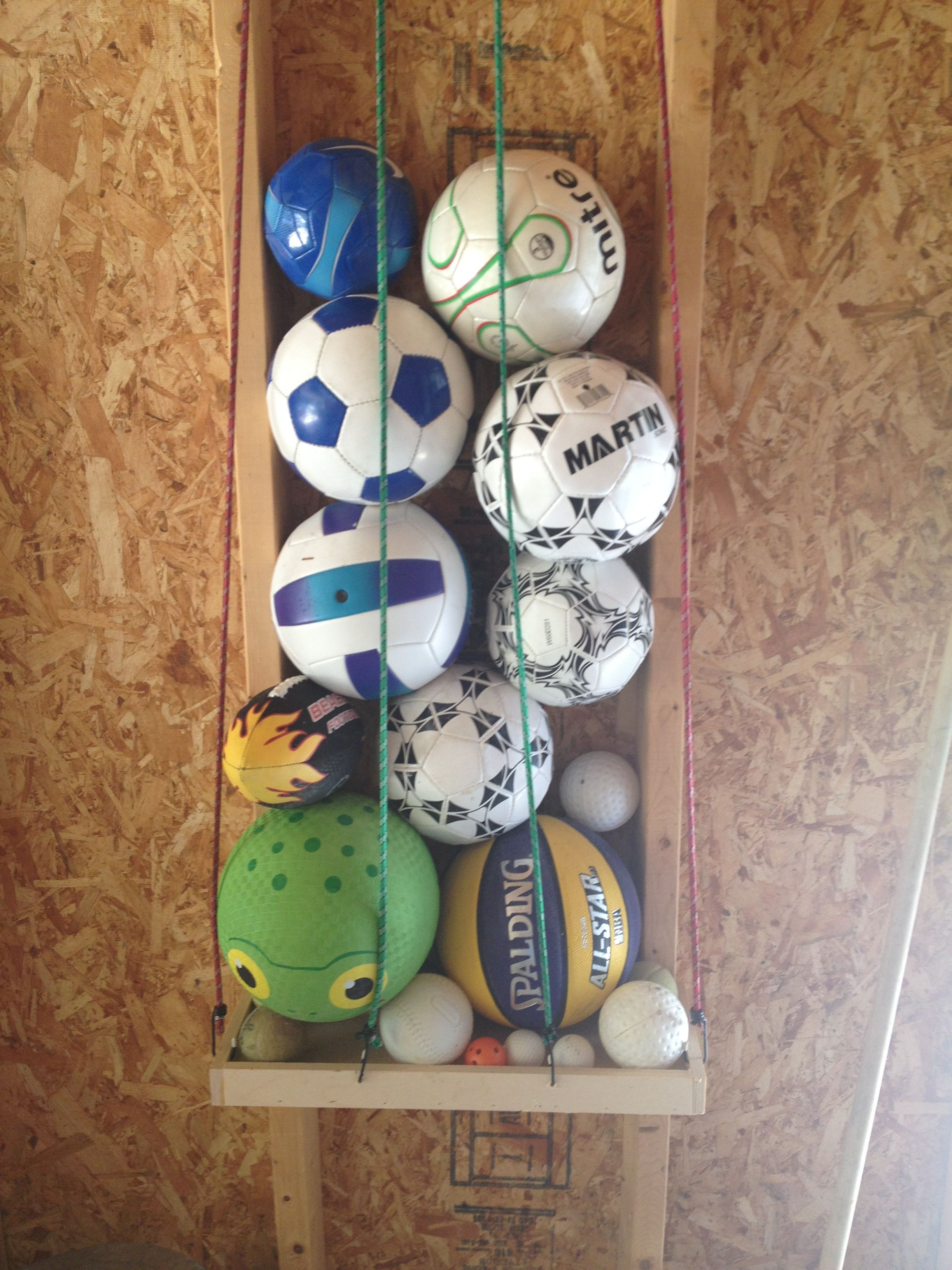 Ball Holder For Garage Made Out Of 1 Store Bungee Cords And