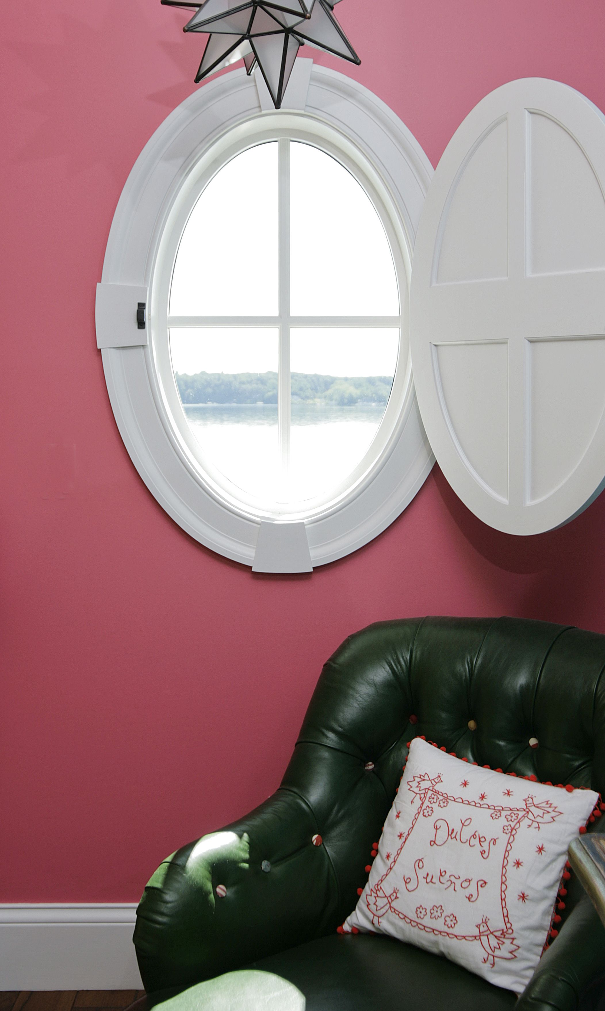 Oval window with custom shutter windows can make a for 12 round window